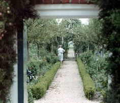 Nancy Lancaster at work in her garden at Haseley Court