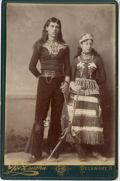 """Cabinet Card, 6 1/2"""" x 4 1/4"""". Portrait of a pair of Wild West performers, attired in western garb, and both holding rifles. Durtha, Delaware, Ohio photographer's imprint and ornate backmark"""