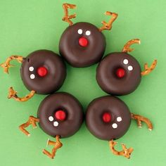 These are Reindeer Donuts... But I think what I'd do is use Hershey kisses and melt them a bit, put mini m's as noses, dots of white chocolate for eyes and stick pretzel pieces in the chocolate for mini's reindeers.