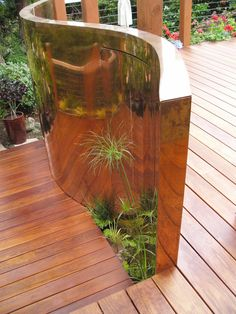 Curved wall separating upper from lower deck Dividing Wall, Buddha Garden, Garden Design, House Design, Lower Deck, Curved Walls, Copper Wall, Stainless Steel Wire, Galvanized Metal