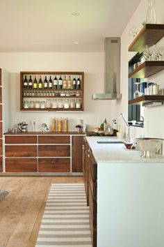 I love the idea of the rectangle shelving for wine.  But why not add other liquor and accompanying bar glasses? It'd be a great way to add a bar when there is no room for a separate area.