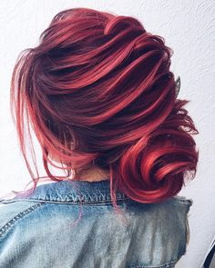 This look is so interesting. The red hair colour is beautiful and the sculptural up do is so enticing. I love it.