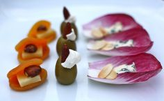 Beautiful Appetizers: Cheddar and Hazelnut Stuffed Apricots, Almond and Cream-Cheese Stuffed Olives, and Endive with Toasted Almond and Blue Cheese. I'd love to try the apricot ones, and substitute cashew or another nut for the hazelnuts.