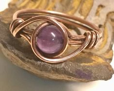 Wire wrapped rings 859906122589930564 - Crown Chakra Amethyst Crystal Ring // Heady Copper Wire Wrapped Amethyst Ring // Minimalist Healing Source by Amethyst Gemstone, Gemstone Rings, Purple Amethyst, Amethyst Birthstone, Diy Rings, Wire Wrapped Rings, Diamond Cluster Ring, Beaded Rings, Wire Rings
