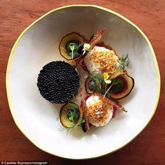 Extravagant: The cafe's caviar-topped salmon with poached eggs, beetroot yoghurt, black-garlic mayonnaise and shards of toasted rye (above) is popular
