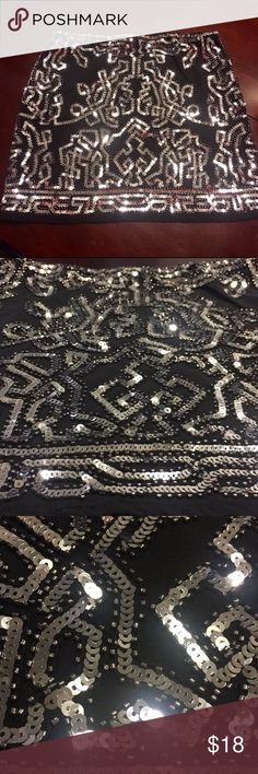 Bead and sequin mini Black and silver mini skirt. New no tags. Stretch fabric and hidden elastic waistband. Zips up on side. Excellent condition no rips or stains Skirts Mini