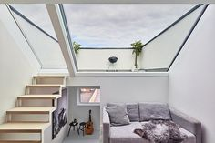 The three-and-a-half-storey house in east London features an enormous single pane window to let in streams of light