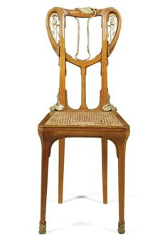 Louis Majorelle (1859-1926) - Side Chair. Carved Mahogany and Gilt Bronze 'Aux Nénuphars' (Lillies), with Cane Seat. Circa 1905.