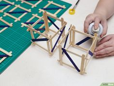 How to Build a Popsicle Stick Tower. Popsicle stick towers are a common engineering project to be assigned in school.Your assignment may have various criteria for height, weight, and number of popsicles, but this guide will give you a. Engineering Projects, Wood Glue, Popsicle Sticks, Diy Wood Projects, Popsicles, Triangle, Tower, Building, Pictures