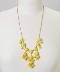 Lustrous resin baubles put eye-catching pop in this statement style. Whether paired with a little black dress or a favorite button-up, the lovely necklace will effortlessly add on-trend charm to any ensemble.Chain: 23'' long with 3'' extenderBib: 5'' W x 3'' LResin/ metalImported