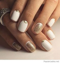 White nails with some gold glitter