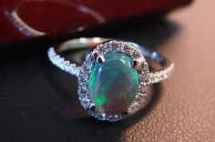 Handmade 18K White Gold Diamond and Black Opal Ring. It's even more beautiful in person!