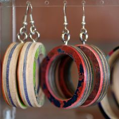 Fun and funky recycled skateboard earrings - available at Practical Art! #recycle #repurpose #jewelry #earrings #Phoenix