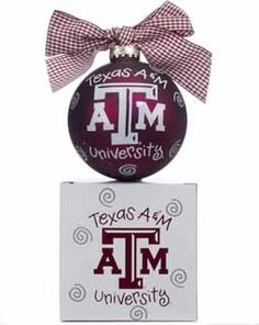Texas A&M University students and Aggies fans everywhere will love this ornament!  The front of the maroon glass ball has the school logo and says Texas A&M University, the back says GIG 'EM AGGIES!  The top has a maroon and white gingham bow and it comes with a matching gift box.  Buy it now for $21.95 at www.ornamentshop.com