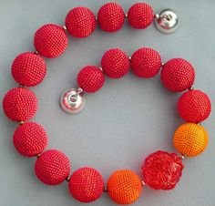 Hildegund Llkerl, she makes fabulous beaded beads & bead crocheted ropes.