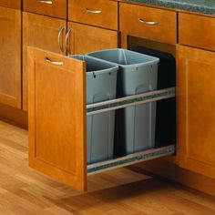 35qt Knape & Vogt USC Double Soft Close Undermount Waste & Recycling Bin - Platinum - 15 Yep, this is what I want so bad to replace our gross icky pull out bin. The one we have is wire and mounted to the cabinet base. you grab it and pull it out so both the door handle, and the bin get dirty plus stuff tends to miss. Blech.