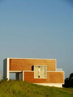 Image 1 of 15 from gallery of Bromelia House / Urban Recycle Architecture Studio. Photograph by Marcio Correia Campos