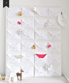 I really like this advent calendar idea - basically just envelopes w/ special messages, gifts or whatever personalization you choose to add to them :)