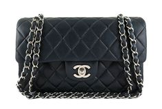 Chanel Black Silver Hardware Medium Classic 2.55 Double Flap Bag  - This piece comes complete with original Chanel box, dust bag and authenticity card. There are no visible stains on the exterior and interior leather. Silver chains and hardware are shiny with no fading or tarnishing. Leather straps do not show signs of wear. Chains can be worn long across the body or doubled on the shoulders. Scuffs and discolouration are present on the corners. Serial number is intact and matches the ...