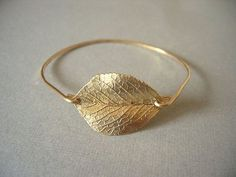 Items similar to Gold Leaf Bangle, Gold Bangle, Gold Bracelet, Valentines Gift on Etsy Leaf Jewelry, Jewelry Box, Jewelry Accessories, Fashion Accessories, Gold Jewellery, Simple Jewelry, Etsy Jewelry, Jewelry Design, Diamond Are A Girls Best Friend