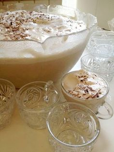 ladies coffee and coffee punch! 1 gallon strong coffee 1 1/2 cups sugar 1 quart whipping cream 1 gallon ice cream chocolate for shaving