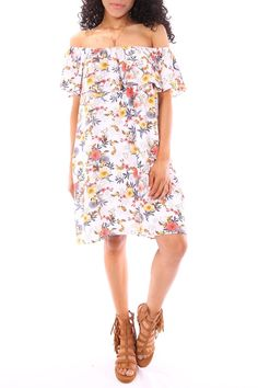 Our Sunshine Garden Dress is absolutely perfect for the summer. This can be dressed up for a night  out or dressed down for brunch with your girlfriends. Pair with a simple wedge or sandal to complete the look.   Sunshine Garden Dress by Entro Inc. Clothing - Dresses Dallas, Texas