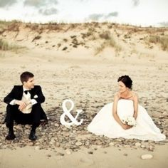 "This is so cute, it just needs the last name written in the sand, so it says Mr. & Mrs. "" "" :) Great beach photo idea"