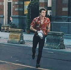 He's even gorgeous while he's running