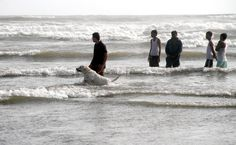 KARACHI: A man enjoying with his dog at sea view beach during the hot day in Provincial Capital.