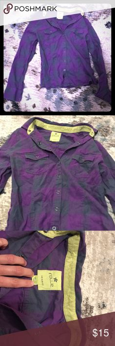 BNWOT Nollie flannel shirt BNWOT Nollie flannel shirt. Says slim fit in the tag, was a Medium at the store if I recall. Tried on at Pac sun, bought and never wore it. I swear my closet eats clothes! Haha! Fits like a true medium (to me). The pattern color is a purple and a greenish. It has yellow in the collar. Nollie Tops Button Down Shirts