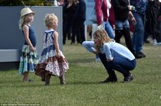 Fun and games: 11-year-old Lady Louise Windsor plays with her younger cousins  at the Quee...