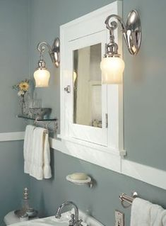 Lincoln Bath Remodeling | Design/Build Bathrooms in Lincoln, Nebraska Craftsman bathroom revitalized with white painted trim and period light fixtures from Rejuvenation.
