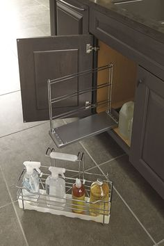 The Decora Cleaning Caddy turns haphazard, under-the-sink disarray into fabulously functional storage with a slide out, removable chrome finish caddy. Kitchen Cabinet Organization, Kitchen Cabinets, Kitchen Appliances, Clever Kitchen Ideas, Cleaning Caddy, Under Sink Storage, Kitchen And Bath, Plumbing, Home Improvement