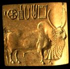 A golden seal found at Harappa has the engraving of a bull and some writing in pictographic text.