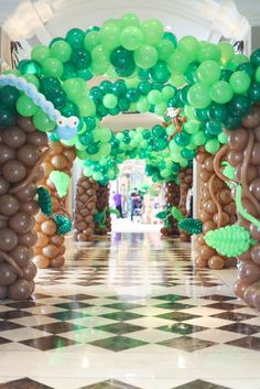 Going Wild with this Animal Jungle Birthday Party balloon decoration. What a great way to start off any party! See more party ideas at CatchMyParty.com