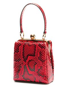 Buying a new bag this season? Make it bright, top-handled, and frame-style—the look's available at every price and easy to wear with neutrals. We love the special skin and fun color of this investment version. Dolce & Gabbana, $2,995, luisaviaroma.com Glamour Mag.
