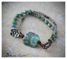 """A rustic Boho style Stacker with handmade artisan lampwork glass focal (BeadedGift), aged Czech glass, and a leather and artisan sterling silver flower button closure. Fits a 6.25""""-7"""" wrist, leave a note if you need the size adjusted."""