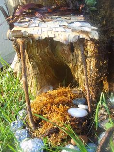 Birch bark shingles on awning for tree stump fairy house