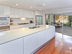 6 Killarney Street, Mosman  SOPHISTICATED CONTEMPORY ELEGANCE  Gourmet chefs kitchen featuring all European stainless steel appliances