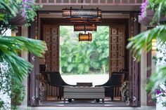 Villa Santai Sorga's entrance sets the tone with its stunning Balinese wooden doors that open to a property long view, all the way to the see. #semarauluwatu #bali