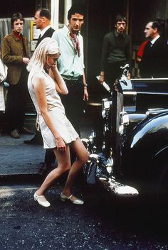 60s chic, checking herself out in the grill of a Rolls Royce on Carnaby Street, London — 1968