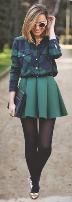 Shop this look for $308: http://lookastic.com/women/looks/button-down-shirt-and-mini-skirt-and-clutch-and-tights-and-ballerina-shoes/3959 — Navy and Green Plaid Button Down Shirt — Dark Green Pleated Mini Skirt — Dark Green Leather Clutch — Black Tights — Gold Leather Ballerina Shoes