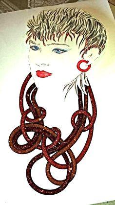 collana lunga composta da tre fili  separati di tre toni di rosso- arancio  da annodare