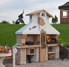 20 Modern Fireplace Design Ideas for Outdoor Living Spaces Outdoor Kitchen Grill, Outdoor Oven, Outdoor Kitchen Design, Outdoor Cooking, Outdoor Barbeque, Parrilla Exterior, Barbecue Area, Wood Fired Oven, Fireplace Design