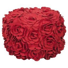 """Wool pouf with a floral motif and three-dimensional petals.    Product: Pouf  Construction Material: Wool  Color: Venetian red  Features: Made in India          Dimensions: 14"""" H x 18"""" Diameter      Cleaning and Care: Rotate frequently. Blot stains."""