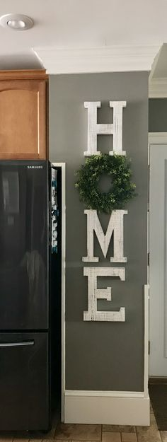 HOME sign with wreat