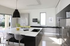 Contemporary style kitchen with dining room lighting. The Caravaggio Pendant.