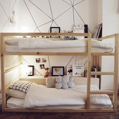 Ikea Kura bed transformed into bunk beds with shelves // Love that geometric wall! All you need is a sharpie and a yardstick