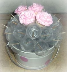 Cupcake Bouquet large bouquet w/ 19 cc using std plastic 5 oz. cups. Or you can use 7 plastic 2 oz. cups used for salad dressing in restaurants  and glue them into a flower pot. mini cc bouquets w/ about 30 minis ... using plastic 1 oz. cups (used for jello shots  I also put toothpicks into each one for extra security