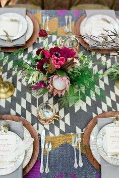 Love this fun tablescape with unique textiles! And a protea centerpiece makes it even better :)